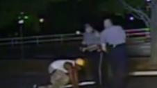 cops kick boy in head